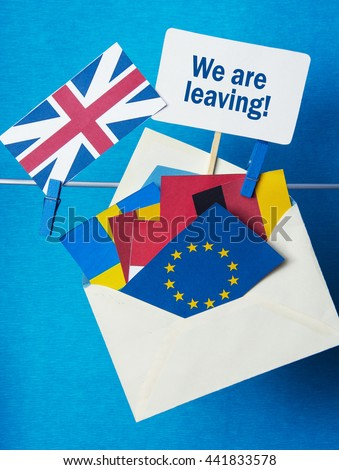 Flags of European Union (flags of different countries eurozone) and United Kingdom, Brexit UK EU referendum concept.  text WE ARE LEAVING - stock photo