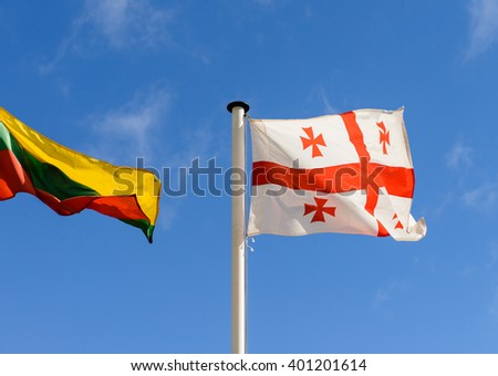 flags of Georgia and Lithuania on the background of the sky - stock photo