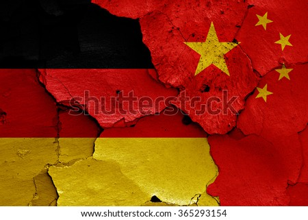 flags of Germany and China painted on cracked wall - stock photo