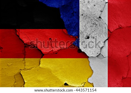 flags of Germany and France painted on cracked wall - stock photo