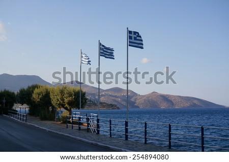 Flags of Greece in Agios Nikolaos, Crete, Greece                                - stock photo