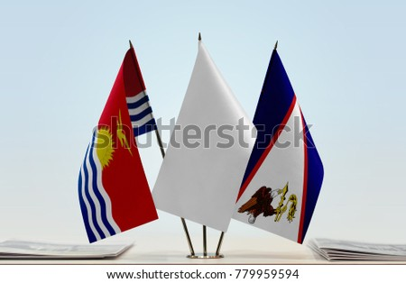 Flags of Kiribati and American Samoa with a white flag in the middle