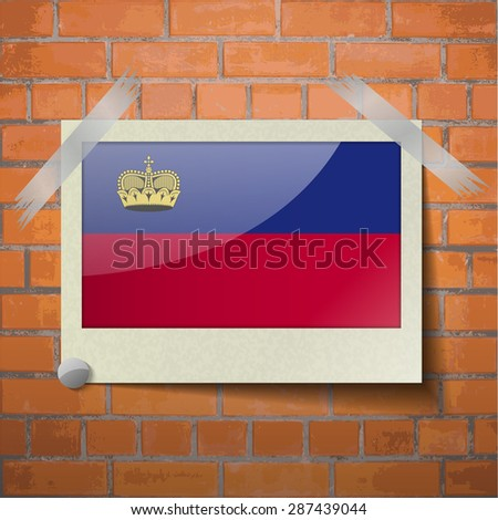 Flags of Liechtenstein scotch taped to a red brick wall.  Rasterized version - stock photo