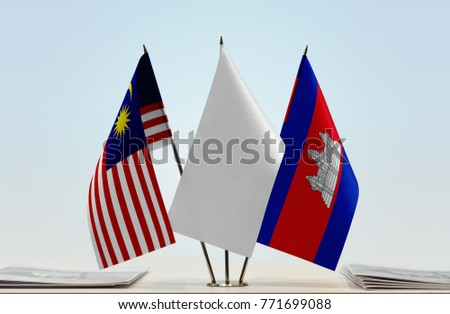Flags of Malaysia and Cambodia with a white flag in the middle