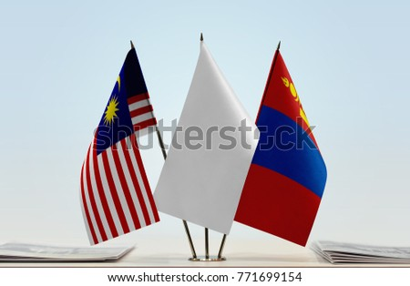 Flags of Malaysia and Mongolia with a white flag in the middle