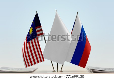 Flags of Malaysia and Russia with a white flag in the middle