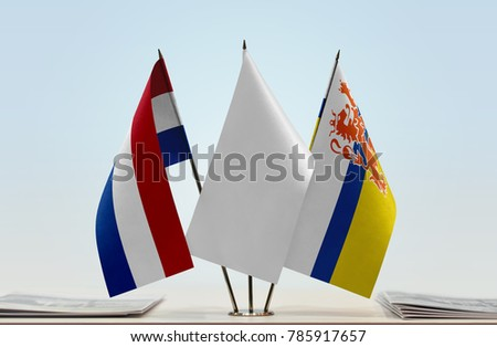 Flags of Netherlands and Limburg (NL) with a white flag in the middle