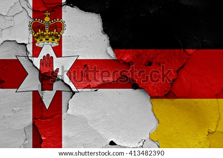 flags of Northern Ireland and Germany painted on cracked wall  - stock photo