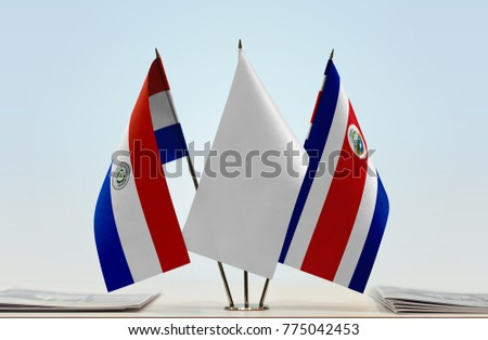 Flags of Paraguay and Costa Rica with a white flag in the middle
