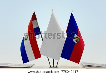 Flags of Paraguay and Haiti with a white flag in the middle