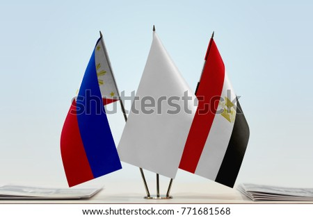 Flags of Philippines and Egypt with a white flag in the middle