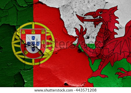 flags of Portugal and Wales painted on cracked wall - stock photo