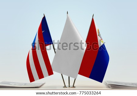 Flags of Puerto Rico and Sint Maarten with a white flag in the middle