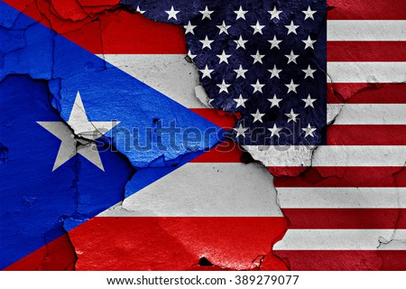 flags of Puerto Rico and USA painted on cracked wall