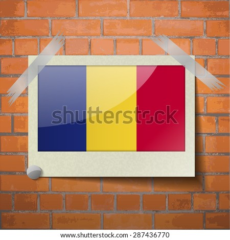 Flags of Romania scotch taped to a red brick wall.  Rasterized version - stock photo