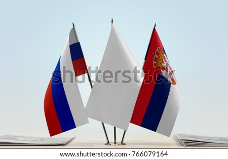 Flags of Russia and Serbia with a white flag in the middle