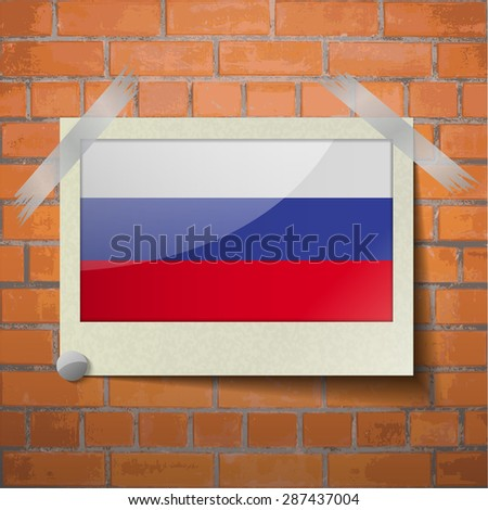 Flags of Russia scotch taped to a red brick wall.  Rasterized version - stock photo