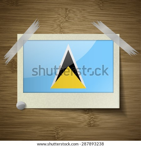 Flags of Saint Lucia at frame on wooden texture.  illustration. Rastrized version - stock photo