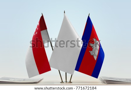 Flags of Singapore and Cambodia with a white flag in the middle