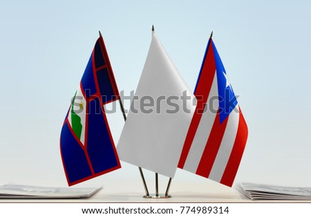 Flags of Sint Eustatius and Puerto Rico with a white flag in the middle