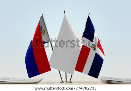Flags of Sint Maarten and Dominican Republic with a white flag in the middle