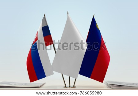 Flags of Slovakia and Liechtenstein with a white flag in the middle