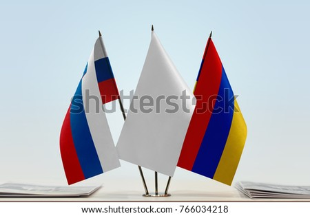 Flags of Slovenia and Armenia with a white flag in the middle