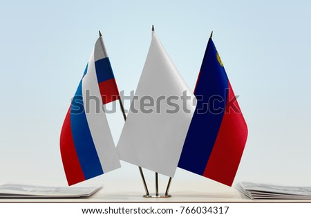 Flags of Slovenia and Liechtenstein with a white flag in the middle