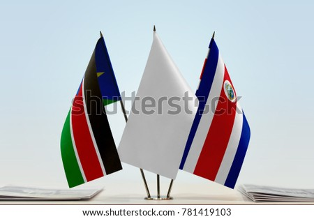 Flags of South Sudan and Costa Rica with a white flag in the middle