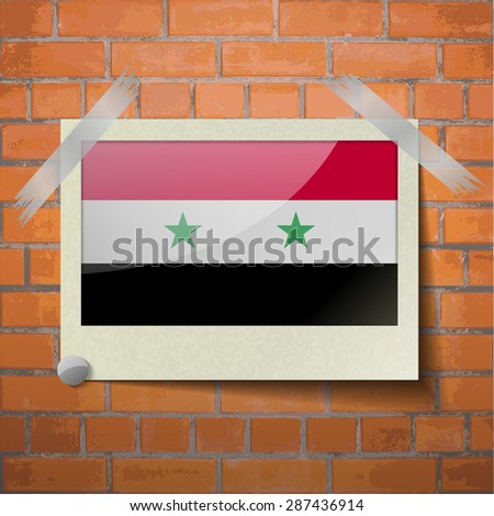 Flags of Syria scotch taped to a red brick wall.  Rasterized version - stock photo