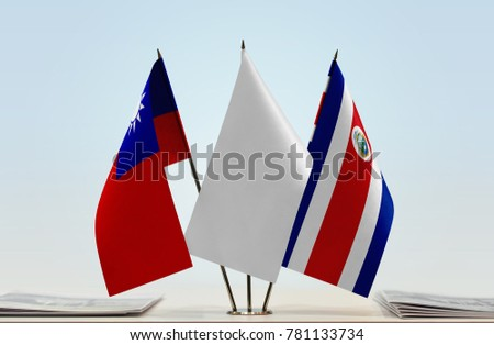 Flags of Taiwan and Costa Rica with a white flag in the middle