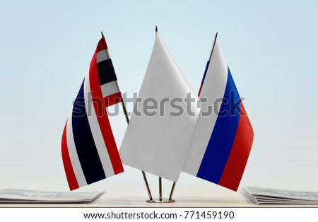 Flags of Thailand and Russia with a white flag in the middle