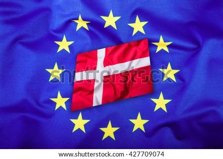 Flags of the Denmark and the European Union. Denmark Flag and EU Flag. Flag inside stars. World flag money concept. - stock photo