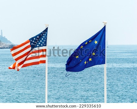 flags of the european union and the usa, symbol photo for partnership, diplomacy, foreign policy - stock photo