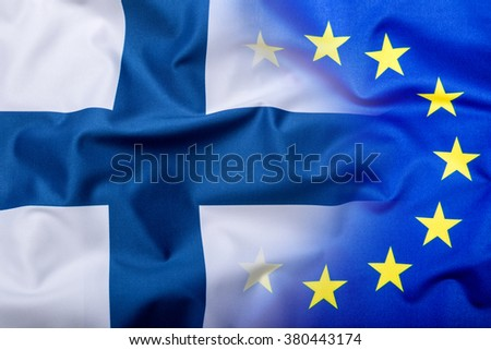 Flags of the Finland and the European Union. Finland Flag and EU Flag. World flag money concept. - stock photo