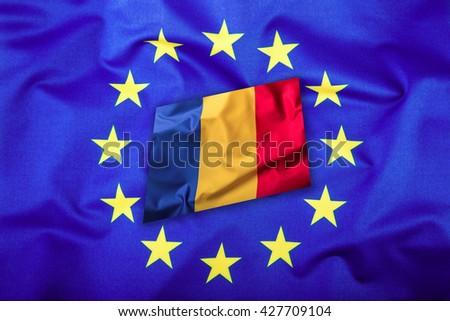 Flags of the Romania and the European Union. Romanian Flag and EU Flag. Flag inside stars. World flag concept. - stock photo