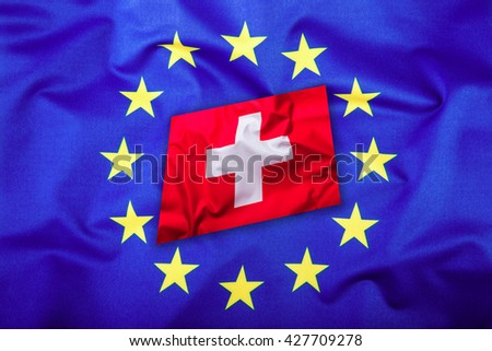Flags of the Switzerland and the European Union. Switzerland Flag and EU Flag. Flag inside stars. World flag concept. - stock photo