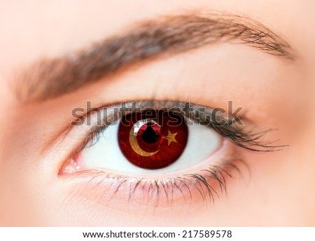 Flags of the Turkish in beautiful female eye  - stock photo