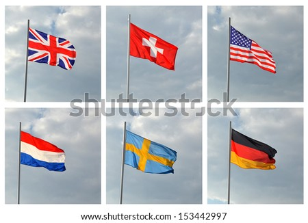 Flags of the world against the sky with clouds. American, German, British, Swiss, Swedish, Luxembourg. Flags developed in the wind