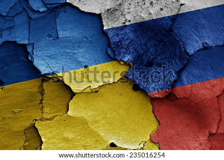 flags of Ukraine and Russia  painted on cracked wall - stock photo