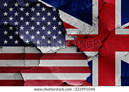 flags of United States of America and UK painted on cracked wall - stock photo