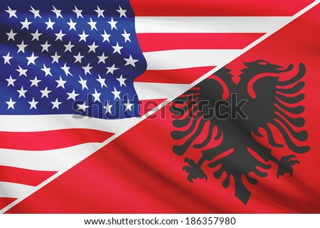 Flags of USA and Albania blowing in the wind. Part of a series.