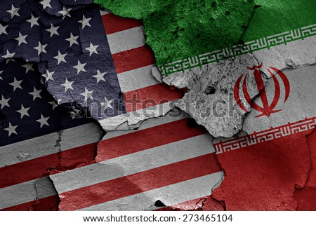 flags of USA and Iran painted on cracked wall - stock photo