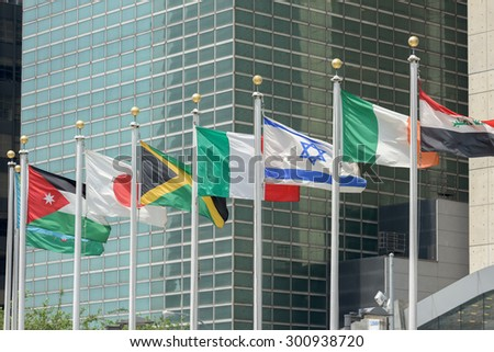 flags waving outside united nations building in manhattan new york - stock photo