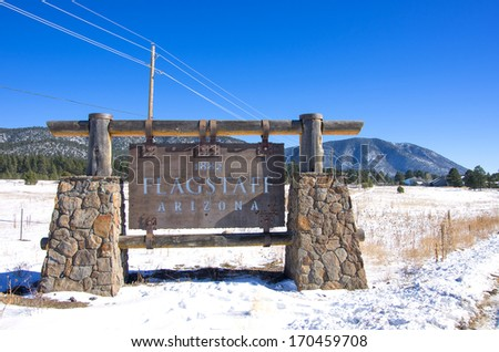Flagstaff sign with snow,Arizona - stock photo