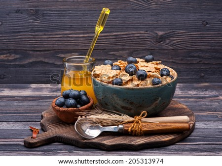 Flakes Cereal with blueberries and honey. Fitness breakfast. - stock photo