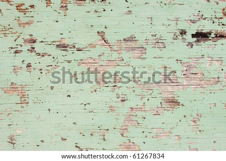 Flaking Green Paint on Faded Wood Background - stock photo