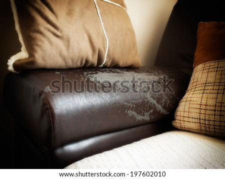 Flaking is a common problem after a while with artificial eco leather on the furniture - stock photo