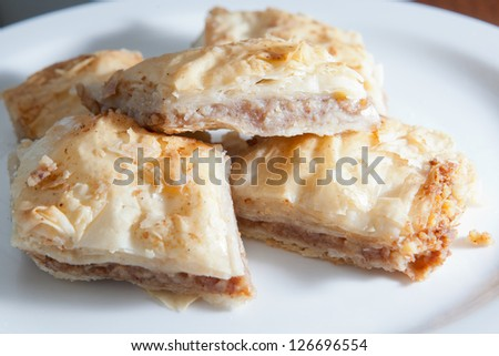 Flaky and delicious baklava on a single plate.