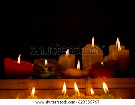 Flame candle isolated on a black background for relaxation